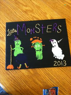 Easy DIY kids Halloween craft on canvas. My little monsters! Footprint witch footprint Frankenstein and footprint ghost! Super cute super easy
