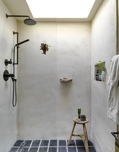 Contemporary Rustic Bathroom: Large square overhead shower stall with built in shelving. .