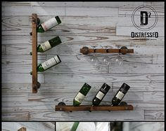 This custom wine rack is made of repurposed black iron pipe fittings and an oak plank. It can hold up to 4 bottles and both the wood and fittings can be positioned in multiple configurations.  The wine rack shown is 35 long by 3-1/2 wide. The oak is stained in red cherry.  *For custom colors and set up of more (or less) holders please contact us for a quote.  **The shipping rate listed only applies to the contiguous United States. For Alaska, Hawaii, or International orders, please conta...