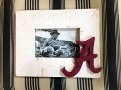 Alabama frame made from reclaimed wood with a photo of Bear Bryant