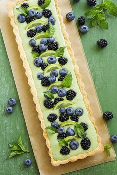 Tart with green tea cream with summer berries.