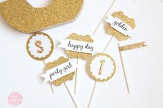Create memorable party decor for a golden birthday using some of American Crafts line of glitter products!