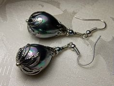 Silver Blue Tahitian Pearl Drop Victorian Earrings Peacock Shell Pearl Gunmetal Black Steampunk Edwardian Bridal Earrings Titanic Temptations 14013 Princess Pearl Teardrops EAqBuS14013 1 Pair of Victorian Style Filigree Dangles Handmade, Free Style Design Matching Necklace Available: https://www.etsy.com/listing/465686646/lustrous-black-tahitian-pearl-victorian Peacock Rainbow Black Shell Pearl Teardrops Tiny Tahitian Swarovski Crystal Pearls Antiqued Silver Gunme...