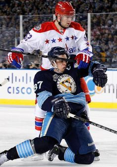 2998e4b6b Winter Classic Pittsburgh Penguins  Sidney Crosby falls to the ice after  being held by Washington Capitals  Mike Green My fav player   am ❤️ing the  loom ...