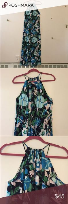 🎉NWT LOFT Floral Halter Maxi Dress🎉 NWT Ann Taylor LOFT Floral Halter Maxi Dress. This elegant Maxi Dress has a small tie belt and slit on left side. Halter ties at the back and can be seen in 3rd picture. Fabric is 100% polyester and so soft! Pairs perfectly with a cardigan or blazer for a night out! LOFT Dresses Maxi