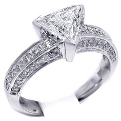 Vintage Style Trillion Engagement Ring (trillion & vintage...that's an oxymoron...but I love this ring!)