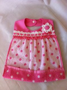This little polka-dot bib is soft and absorbent as well as very stylish. The yoke is cotton with crochet cotton trim. The woven ribbon is 100%