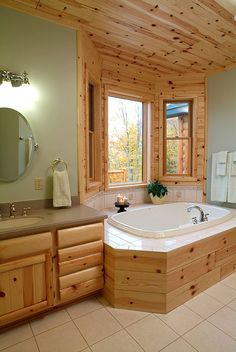 Master bedroom  - prefinished 6-inch tongue & goove knotty pine paneling with log style bathroom cabinet