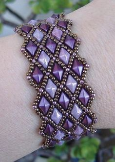 "This beaded pattern tutorial is a DIGITAL FILE, downloadable in PDF file format ONLY. Once payment is confirmed, you will receive an email with a link to download your PDF pattern. If you have any problems downloading your PDF pattern, please contact me. I will be more than happy to send you your pattern via email instead. DIAMOND LATTICE BRACELET ©2017 Deborah Roberti Use size 11 seed beads and two-hole diamond beads (DiamonDuo or GemDuo beads) to create ""columns"" of diamonds and then fill"