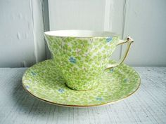 Vintage Lime Green and Turquoise Chintz teacup and saucer.: