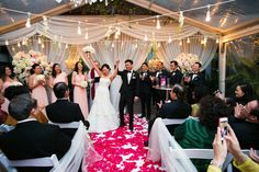 It's now official! Floral & Drapery by Floral Events | Tent from Aztec Rentals | Lighting by Impressive Events & Design | Venue at 5226 Elm | Photo by Callaway Gable
