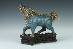 CHINESE CLOISONNÉ ENAMEL QILIN-FORM CENSER. Qing Dynasty. - 8 7/8 in. long.