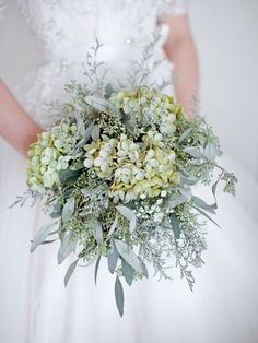 Winter Wonderland | BridalGuideThe bride's bouquet of baby's breath, eucalyptus and green hydrangeas was arranged by Classic Floral of Fargo.