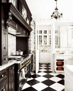Designing Around Black & White Checkerboard Kitchen Floors. These appear to be VCT tiles. Love the kitchen with black cabinets and ornate trim