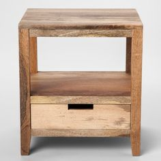 Bring a touch of rustic style into your home with this 1-Drawer Wood Accent Table from Threshold™. The mango wood accent table has a natural finish that'll bring texture to any space. Keep it next to your sofa as a place to display a lamp, coasters and a decorative sculpture. Thanks to the bottom drawer, you can keep necessities like remotes, magazines and manuals out of sight but in close reach.
