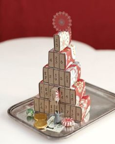 Advent Calendar w/matchboxes....place a slip of paper with Bible passages to read for each day......