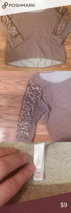 TGIF SALE 💥Womens Tan sweater w sequin Sleeves Womens tan crewneck sweater with gold sequin sleeves. Super comfy and still cute. Slightly shorter in front than in back. Meant to be a little baggy so can fiit a variety of sizes. First meas. Is waist. Second is put to waist. Third is across bust. Like new no stains tears or pulls.   Smoke and pet free home.  Same day shippingg. Lots od other womens clothes in my closet. Bundle and save or make me an offer 😊🛍👗💜 happy poshing ! Xhilaration…