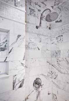 A view of this custom shower made from a design mixture of large marble subway tiles, small basket weave, and upper square tiles. Chrome rainhead shower with trim and built-in niche. shower Karr Bick Kitchen and Bath Benjamin Moore Ocean Air, Rainhead Shower, Super White Quartzite, Veranda Interiors, Reclaimed Wood Mirror, Home Addition Plans, Marble Subway Tiles, White Master Bathroom, Navy Wallpaper