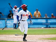 TOUCH 'EM ALL - Cuba's Jose Garcia rounds the bases after hitting a walk-off home run to give his team the bronze medal in a 7-6 victory over Puerto Rico. (Julio Cortez/Associated Press)