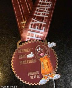 Hershey Half Marathon Medal (2012) | Run It Fast. Alright I HAVE to run this race someday, a race centered around my favorite thing...CHOCOLATE!!!! There is a chocolate aid station people!!!!!! No way!!!!
