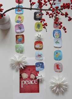 Christmas paper garland with kids drawings and paper stars. Love these!