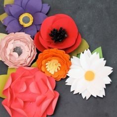 Grab some scissors and a couple basic paper punches! That's all you need to make these pretty flowers.