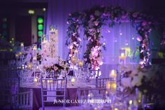 Beautiful centerpieces at a wedding at the Bath Club. Flowers by Avant Gardens Miami Planning by Jamie Lipman of Absolute Events. Linens by Nuage Designs Inc. In house photography by Junior Gamez Photography