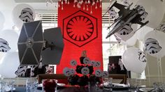 Star Wars, The Force Awakens, First order tablescape birthday party!!! So easy...red craft paper with first order emblem colored in with black sharpie for banner.  printed stormtroopers and taped on lots of white balloons.  Printed out black and white star wars images, cut out and put them on presents wrapped in black paper.  Printed out cupcake toppers and put them on toothpicks.   Ships were bought from Michaels only $14 each.  So simple but a huge impact.  Son loved it....