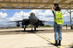 Republic of Singapore Air Force Assistant Expert Luo Youyang, 428th Fighter Squadron crew chief, taxis an F-15SG fighter jet from the 428th Fighter Squadron located at Mountain Home Air Force Base, Idaho, under a sunshade at Davis-Monthan Air Force Base, Ariz., July 7, 2015.