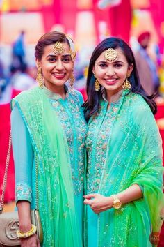 Sister of the Bride - Bridesmaids wearing Matching Outfits, Aquamarine Front Embroidered Suits with Mint Green Net Dupattas | WedMeGood | Gold Maang Tikkas and Earrings #wedmegood #sisterofthebrideoutfit #sisterofthebride #aquamarine #mintgreen #matchingoutfits #bridesmaids