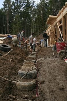 Tire wall is begun for front Greenhouse hallway in Main House Earthship, image by Monica Holy
