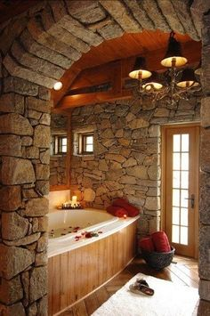 Rustic Master Bathroom with Wood paneling, Casement, Stacked stone wall, Minka Lavery Bellasera 5 Light Chandelier, Bathtub