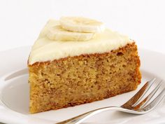 Fluffy, golden banana cake is made even more delicious when spread with a generous dollop of a sweet, creamy cheese frosting. Perfect served slice as a rich weekend treat.