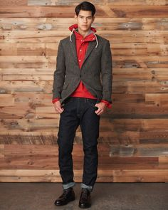 Blazer over hoodie. Denim blue jeans. Brown leather shoes.