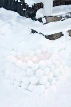 We used to make these snow ball lanterns at wintertime in finland and put a candle inside of it. They would look really pretty in the dark winter night.