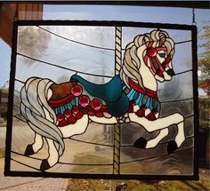 This is beautiful!    Stained Glass Carousel Horse Panel by carolvs40 on Etsy, $410.00
