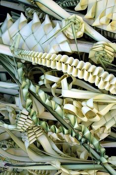 Before the religious events of Palm Sunday begin, crafts people are busy preparing the palms that will be used during