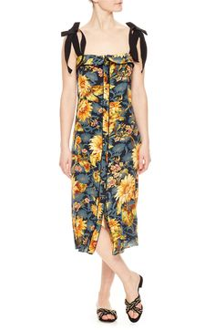 Like a wearable garden stroll, this vibrant dress, cut in pure silk, features ribbon straps and a flattering square neckline. Kawaii Fashion, 80s Fashion, Spring Fashion, Fashion Trends, Celine, Sunflower Dress, Sunflower Print, Hermes, 70s Mode