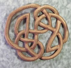 Knot of Infinity -Traditional Celtic Wood Carved Knot -Book of Kells MEANING:  Found in the Book of Kells, the Infinity Knot is a completely asymmetrical piece. It is carved on one continuous line, that to the Celts, represented eternity.     It is traditionally given as a wedding or anniversary gift.  $78.00