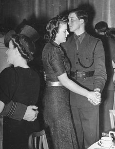 "London, 1940: Second Lieutenant Ronald Kershaw and his date, dancing to the tune of ""In an Eighteenth Century Drawing Room."""