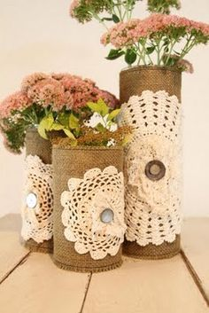 twine and doily covered vases - idea to distinguish the glass vases leftover from mere's wedding...