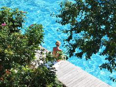 "Our new infinity-pool is located on the southwest side of Sonnenburg hill in shimmering azure and features a splendid view down towards the Rienz and the Pfunderer Mountains. We came across another gem while working on the lawn: remnants of walls, terraces and stairs from the Baroque period. By now they are exposed and restored. Atmospheric spots which extend on 6 levels downwards (south) towards the river emerged in the process. Enjoy the privacy of these idyllic natural ""booths""!"