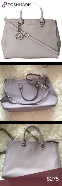 Michael Kors Large Dressy Satchel Tote Bag Grey Gorgeous authentic Michael Kors tote in great shape. Has some light staining on the back but looks to be almost the same as the bag color. As well, some small ink stains in interior which might be removable. Side snaps. Double zip top. With detachable long strap. Perfect for school or work. No trades! Michael Kors Bags Satchels