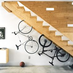 Under-stair bike storage. Clever use of the dead space (but my wife would never go for this...!)