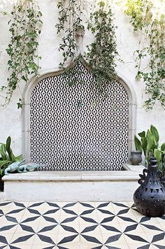 Beautiful black and white Heath ceramic tiled fountain and patio.