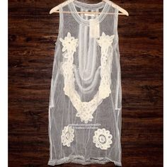 FREE PEOPLE Lace Dress Eyelet Cocktail Mini Shift Size Large. New With Tags. $240 Retail + Tax.   Gorgeous off-white mesh shift prom dress featuring crochet lace detailing throughout. Bottom hem is scalloped. Sheer.  By Candela for Free People.   Nylon Mesh. Imported.   ❗️ No trades or holds.    Bundle 2+ items for a 20% discount!    Browse through my closet for even more items from this brand!   ✔️ Items are priced to sell, however reasonable offers will be considered when submitted using…
