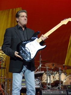 Glenn with a guitar autographed by Eagles
