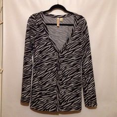 SALE‼️Zebra Print Cardigan Bought from a consignment shop, but never worn by me. Soft material, some pilling. Grey with black zebra stripes. Button closure. Size medium. Sweaters Cardigans