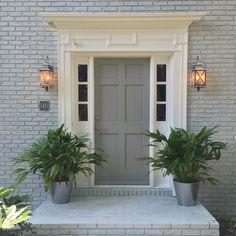 New house exterior color scheme. Sherwin Williams Gray Screen (Brick) and Ear Grey (door).