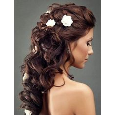 Long beautiful wedding hairstyle with flowers